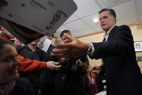 Republican presidential candidate and former Massachusetts Governor Mitt Romney signs autographs at Chez Vachon Restaurant in Manchester