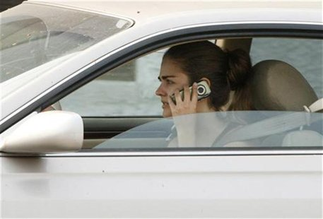 A woman talks on her cell phone while driving in Burbank