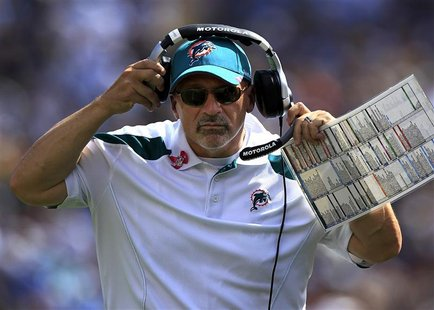 Dolphins head coach Tony Sparano adjusts his headset as he coaches against the Chargers during NFL game in San Diego