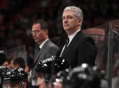 Los Angeles Kings' coach Murray watches his team during the NHL hockey opening game against New York Rangers at Globen Arena in Stockholm