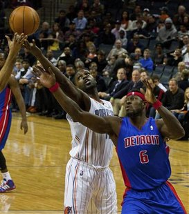 Charlotte Bobcats Mohammed battles for a rebound against Detroit Pistons Wallace during their NBA basketball game in Charlotte