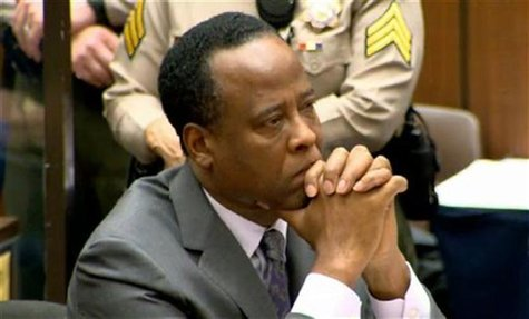 Dr. Conrad Murray listens as Judge Michael Pastor sentences him to four years in county jail for his involuntary manslaughter conviction of
