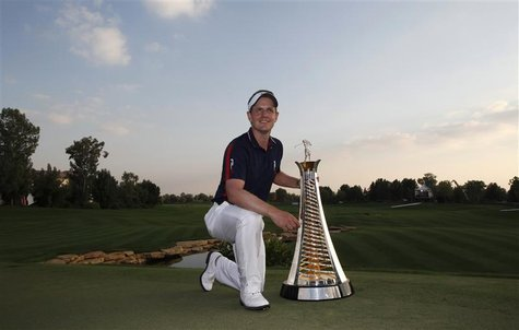 Donald of England poses with the Race to Dubai trophy after the final round of the Dubai World Championship
