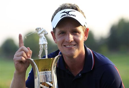Donald of England poses with the Race to Dubai trophy after the final round of the Dubai World Championship in Dubai