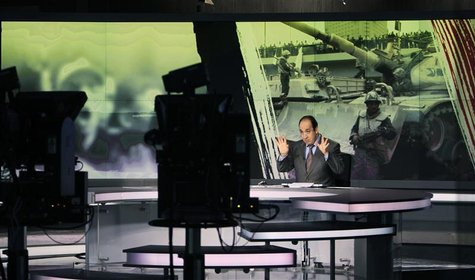 Announcer Abdul Samad Nasser is seen in the studio of the Arabic Al Jazeera satellite news channel in Doha in this February 7, 2011 file pho