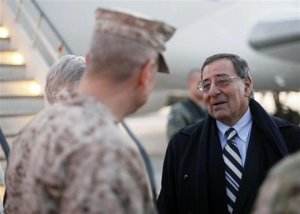 U.S. Secretary of Defense Panetta is greeted by General Allen as he arrives in Kabul