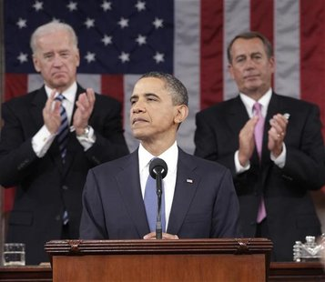 President Barack Obama is applauded by House Speaker John Boehner and Vice President Joe Biden while delivering his State of the Union addre