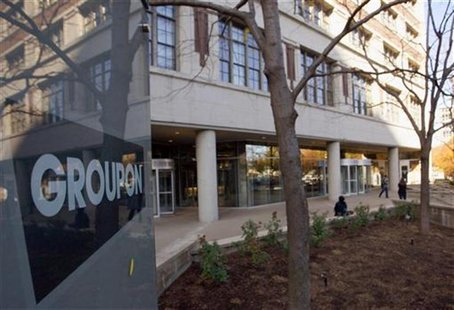 People enter and leave Groupon Inc corporate office and headquarters in Chicago