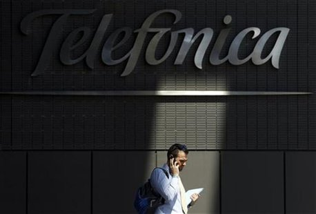 A man talks on his cell phone outside Telefonica headquarters in Madrid