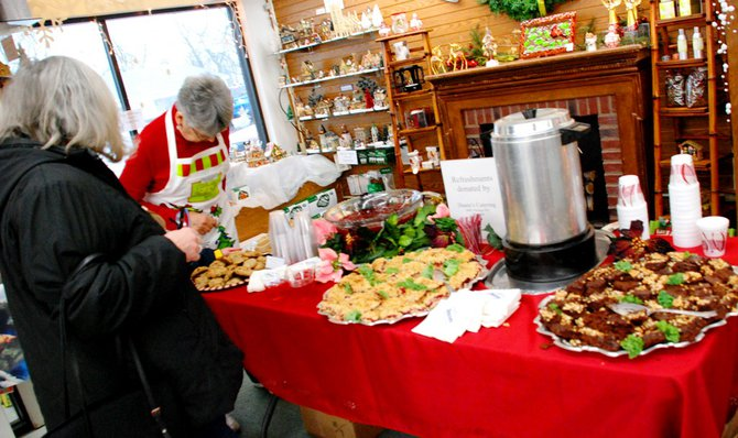 Lori Moore brings the Potluck Pals to Westlake Drug on Portage Rd to raise funds for the YWCA Domestic Abuse Shelter - and raise funds they did - $2165! 12/14/11