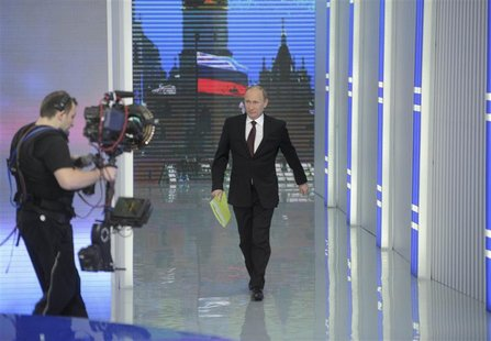 Russian Prime Minister Vladimir Putin arrives for a televised question-and-answer session in Moscow