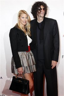 Howard Stern and his wife Beth Ostrosky pose on the red carpet before The New York Friars Club Roast of director Quentin Tarantino in New Yo