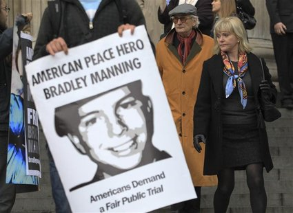 People leaving the St Paul's Cathedral annual Thanksgiving service look at a protest in support of Bradley Manning in London