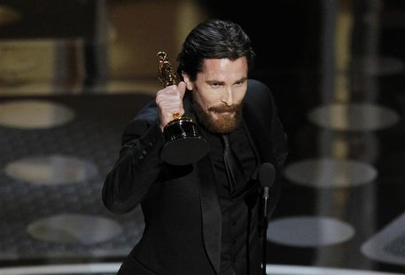 British actor Christian Bale accepts the Oscar for best supporting actor during the 83rd Academy Awards in Hollywood