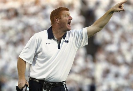 File photo of Penn State assistant football coach McQueary shouting instructions to his team while playing against Alabama at Beaver stadium