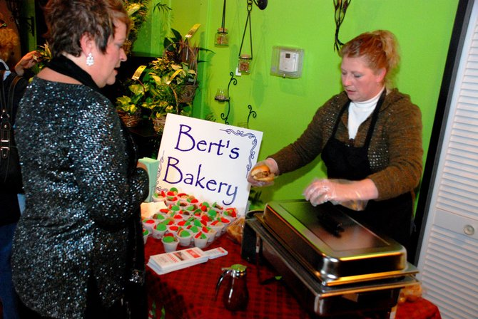 Lori Moore and the Potluck Pals set up camp at Seiverts Floral to rally support for the Kalamazoo Holiday Food Drive - 12/15/11.  The Pals chipped in to the tune of $1438!