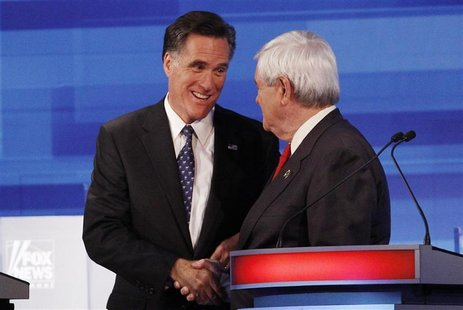 Republican presidential candidates Romney and Gingrich shake hands at the conclusion of the Republican Party presidential candidates debate
