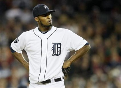Detroit Tigers relief pitcher Al Alburquerque reacts after called for a balk which scored New York Yankees' Alex Rodriguez during the fifth