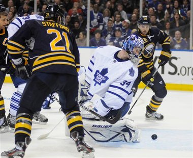 Maple Leafs' Reimer makes save on Sabres' Stafford and Vanek in Buffalo
