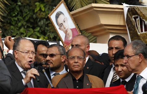 Tunisia's President Marzouki looks on as Assembly President Ben Jaafar addresses Tunisians during a ceremony marking the first anniversary o
