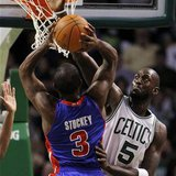 Detroit Pistons guard Rodney Stuckey has his shot partially blocked by Boston Celtics forward Kevin Garnett in the first quarter of their NB
