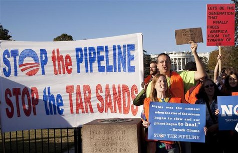 Demonstrators call for the cancellation of the Keystone XL pipeline during a rally in front of the White House in Washington