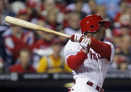 Philadelphia Phillies' Rollins hits a double against the St. Louis Cardinals during Game 2 of their MLB National League Divisional Series ba