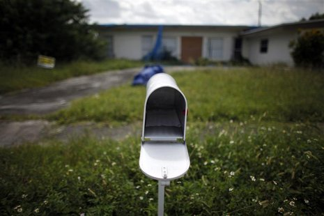An empty mail box is seen at the front door of a foreclosed house in Miami Gardens, Florida in this September 15, 2009 file photo.