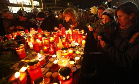 People light candles in tribute to late former Czech President Havel in Prague