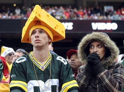 Green Bay fans watch the end of Kansas City's win in their NFL game in Kansas City, Missouri