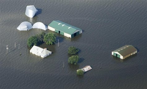 An aerial view of a farm north of Council Bluffs, Iowa, submerged in Missouri River flood waters