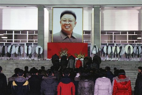 North Koreans make a call of condolence for deceased leader Kim Jong-il in Pyongyang