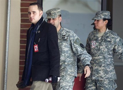 Lamo, former computer hacker who informed authorities about PFC Manning, departs from a military Magistrate Court facility at Fort Meade