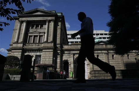A man walks past the Bank of Japan headquarters building in Tokyo
