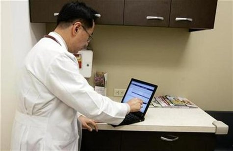 A doctor enters a note in a patient's electronic medical record