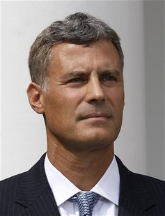 New Chairman of the Council of Economic Advisers Alan Krueger looks on in Washington
