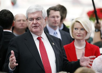 Republican presidential candidate and former U.S. House Speaker Newt Gingrich and his wife Callista talk to customers at the Hy-Vee grocery