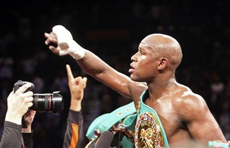 Mayweather Jr. of the U.S. celebrates his victory over WBC welterweight champion Ortiz, also of the U.S., after their title fight in Las Veg