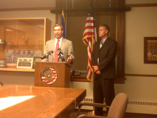 Brown County District Attorney John Zakowski, at podium, and Wisconsin Attorney General J.B. Van Hollen announce an expansion of the state's election fraud task force, July 29, 2010. (courtesy of FOX 11)