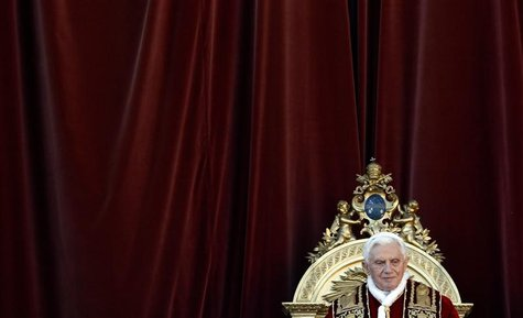 Pope Benedict XVI attends as he delivers Urbi et Orbi Christmas Day message from the central balcony of Saint Peter's Square at the Vatican