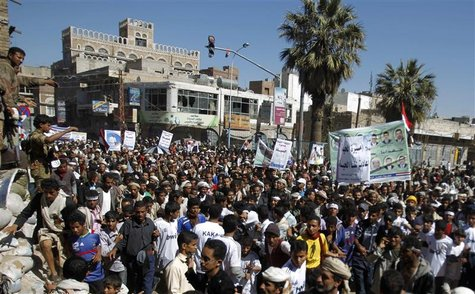 Anti-government protesters march to demand that Yemen's outgoing President Ali Abdullah Saleh be tried, in Sanaa.
