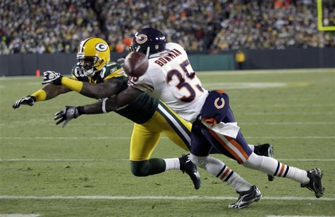Bears cornerback Bowman is charged with holding against Packers wide receiver Jones in the second half during their NFL football game in Gre