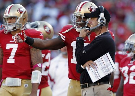 San Francisco 49ers coach Harbaugh talks with Edwards during their NFL football game in San Francisco