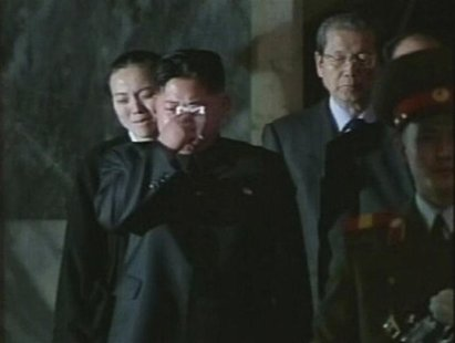 North Korea's new leader Kim Jong-un cries as his father, North Korea's late leader Kim Jong-il, lies in state in this still image taken fro