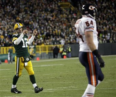 Packers quarterback Rodgers celebrates a touchdown against the Bears in the second half during their NFL football game in Green Bay