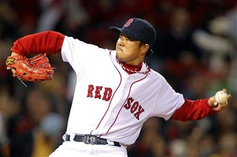 Boston Red Sox relief pitcher Hideki Okajima pitches against the New York Yankees during their MLB American League baseball doubleheader at