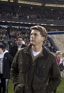 Yankees managing partner Steinbrenner walks the sidelines before Army plays Notre Dame in their NCAA football game at Yankee Stadium in New