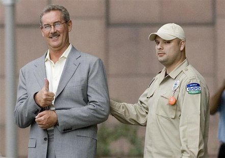 "Texas billionaire Allen Stanford flashes a ""thumb up"" as he leaves the Federal courthouse in Houston, Texas"