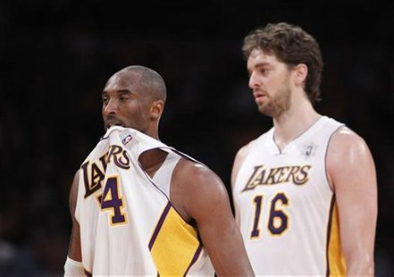 Los Angeles Lakers' Kobe Bryant and Pau Gasol of Spain walk towards the bench for a time out after losing possession of the ball against the