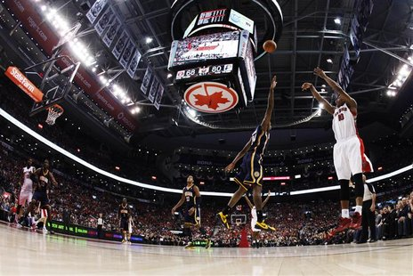 Toronto Raptors' DeRozan puts up a three-point-shot against Indiana Pacers' George during their NBA game in Toronto